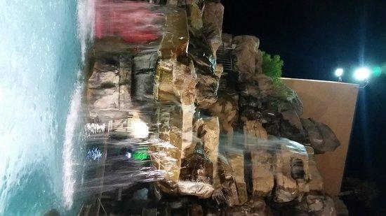 Days Inn Panama City Beach/Ocean Front: Waterfall pool at night