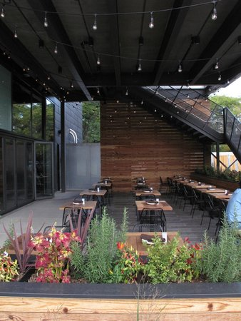 The Promontory Outdoor Dining Sheltered By Music Venue And Deck Above