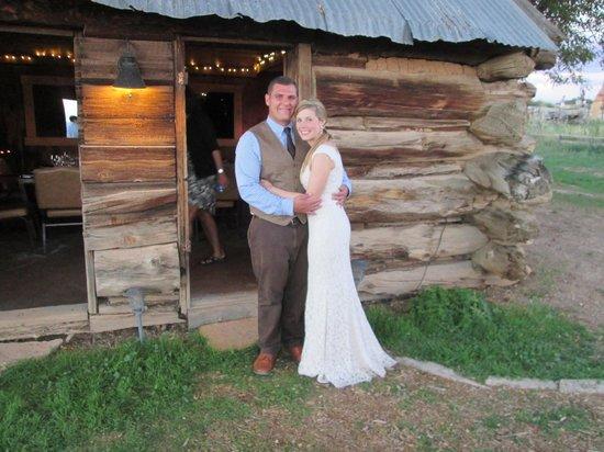 Mrs. & Mrs. outside the beautiful barn