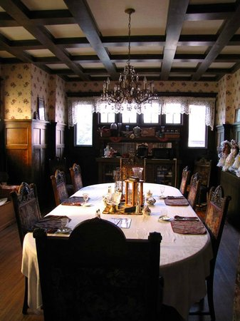 Victorian Guest House: Dining room with dark, hardwood paneling