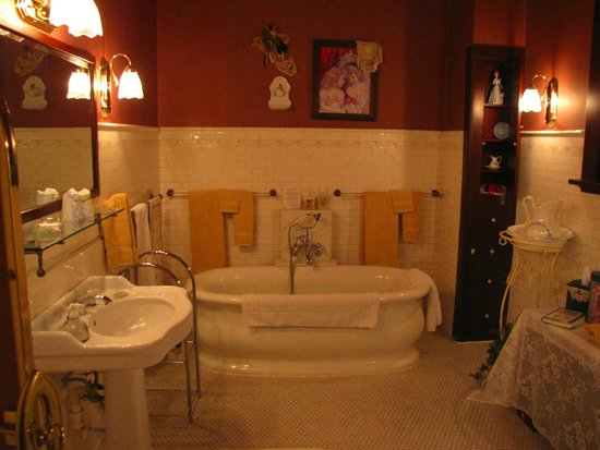 Victorian Guest House: Grand Coppes bathroom, with 1887 bathtub and adjacent stained glass