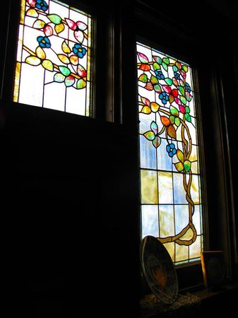 Victorian Guest House: Stained glass windows over dining area. Locally commissioned.