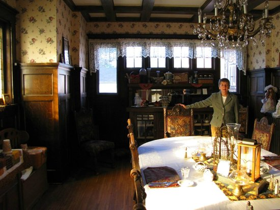 Victorian Guest House: Coppes family dining room, filled with stained glass and antique table