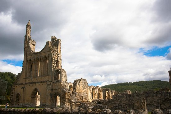 View of Byland Abbey's front facade from the road.