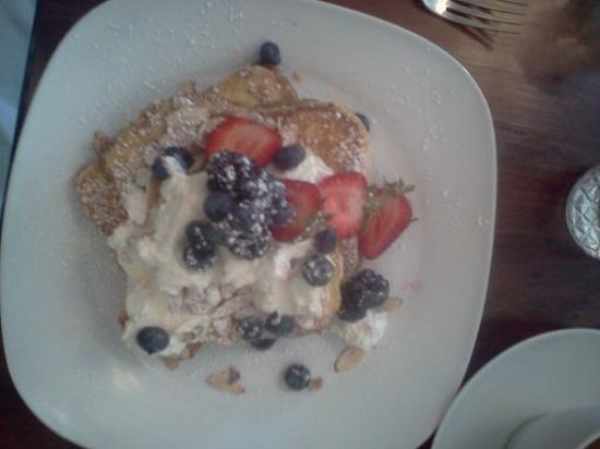 Savvy on First : Brioche French toast with lemon crema, fresh berries and slivered toasted almonds.  Yummy!
