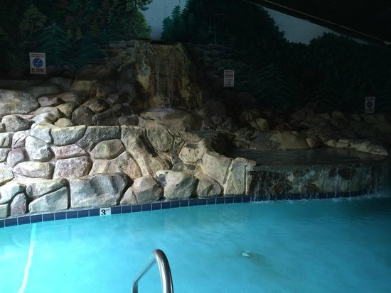 indoor waterfall into pool Picture of The Edgewater Hotel