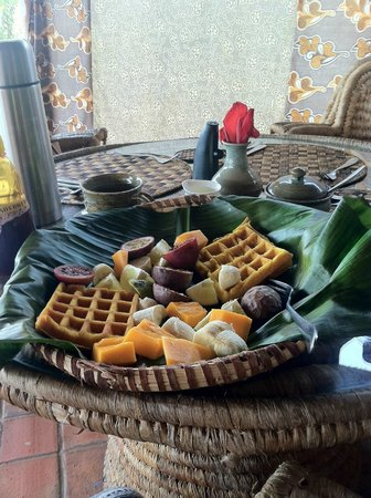 Waffles and fruit with a view of Lake Kivu
