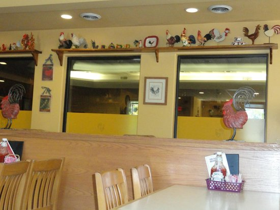 Little Red Rooster : Various rooster figurines on the restaurant wall. Rustic and homey.