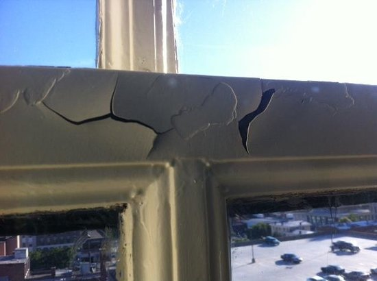Seelbach Hilton: Peeling paint on window frame #1