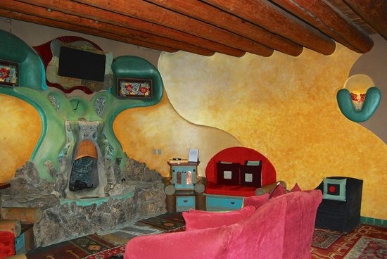 Earthship Biotecture Living Room With Waterfall Fireplace