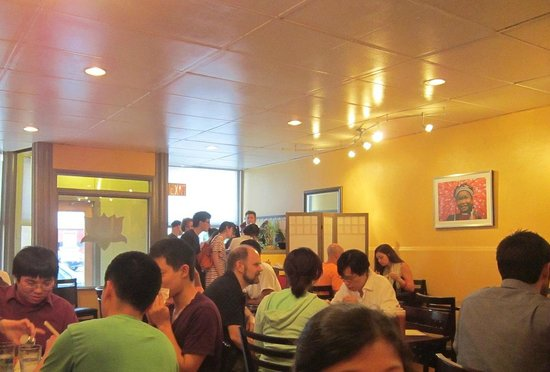 Dinner crowd at a light and airy saigon kitchen picture for Asia cuisine ithaca ny