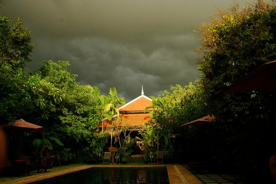 The Moon Boutique Hotel: The pool area and restaurant as a storm rolls in