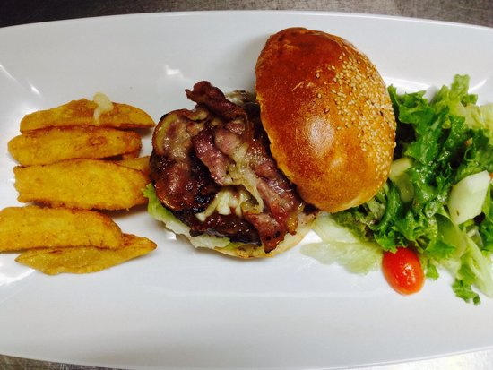 The Halia at Westlake: Aussie beef burger with bacon, cheese, pickle, garden salad and potato wedges.