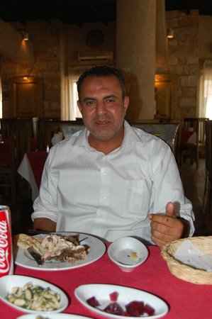 Andrea Mariouteya: Our Driver Mohammed having lunch with us...