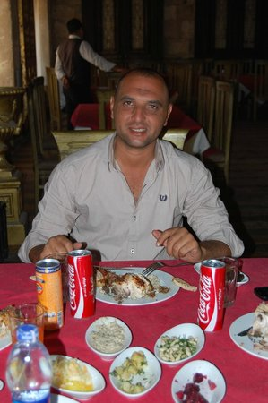 Andrea Mariouteya: Our Guide Youssef enjoying a great lunch...