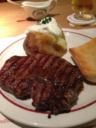 Buffalo Steakhaus: Ribeye 250g with baked potato and garlic bread