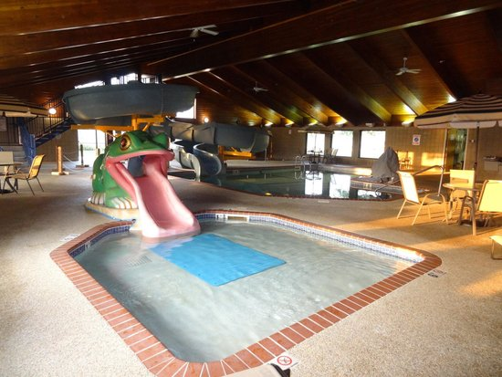 "AmericInn Lodge & Suites Shakopee - Canterbury Park: Small ""frog"" slide with large slide in the background."