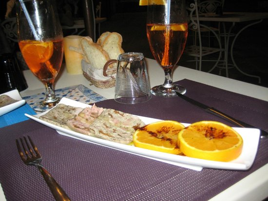 Osteria Il Gallo nel Pozzo: Pheasant and mushroom terrine with Sicilian orange