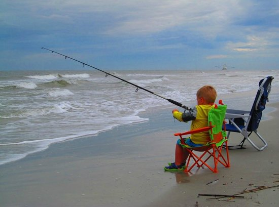 Egret Point by Spinnaker Resorts: Young fisherman on Coligny Beach