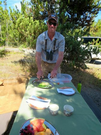 Jackson Hole Wildlife Safaris - Day Tours: Kyle preparing lunch in the Grand Tetons