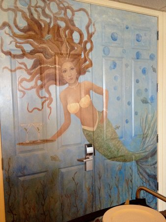 Daytona Beach Resort and Conference Center : Beautiful Mermaid in the restaurant- well a painting!