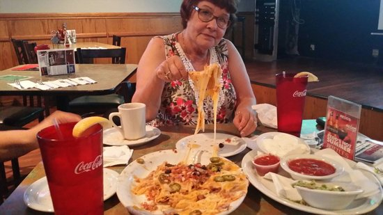 """Baddogs Bar & Grill: My grandma eating nachos with...""""A sarcastic amount of cheese. """"  Great place with great food!"""