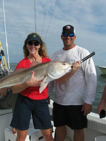 Papa Bear Charters: Sheri's bull red fish along with Captain Mike.