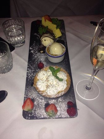 Beach Blanket Babylon : Trio of desserts.  Chocolate brownie Strawberry cheesecake  Lemon meringue