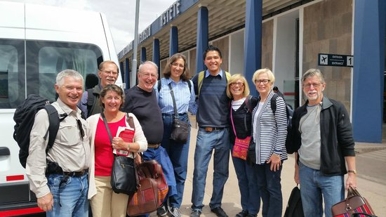 Machu Travel Peru Day Tours: Our group of 8 with Jhonathan of Machu Travel Peru in the middle