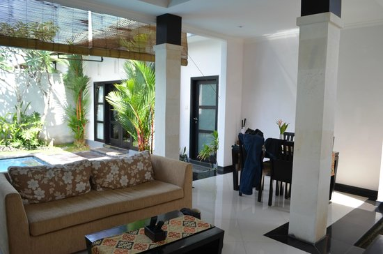 Grand La Villais Villa and Spa Seminyak: out door sitting area with TV and kitchen over looking pool area
