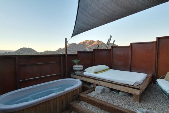 Sacred Sands: Private patio with outdoors bed, jacuzzi, and shower.