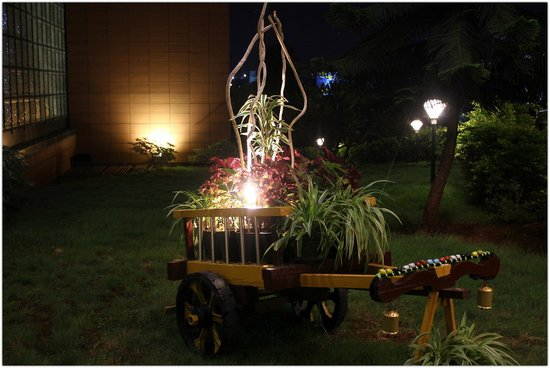 The Orchid Pune: At the entrance. Decorated miniature cart....