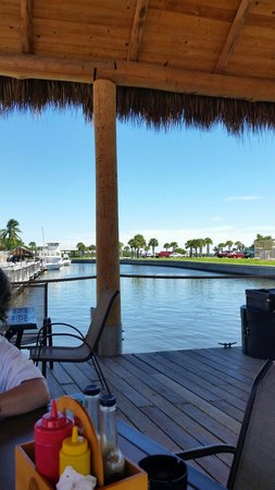 Flounders Restaurant and Tiki Bar: On the deck eating and enjoying the day.