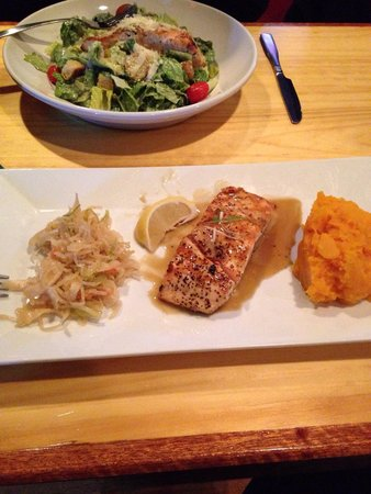 Tuckermans Restaurant & Tavern: Salmon with butternut squash and slaw. In the background, Caesar Salad with Salmon.