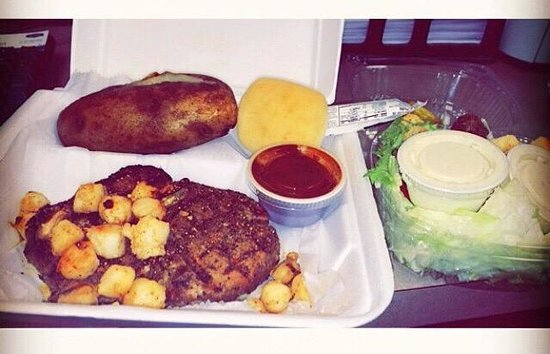Rusty's Riverfront Grill: filet with scallop topping, baked potato, A1, roll, & salad