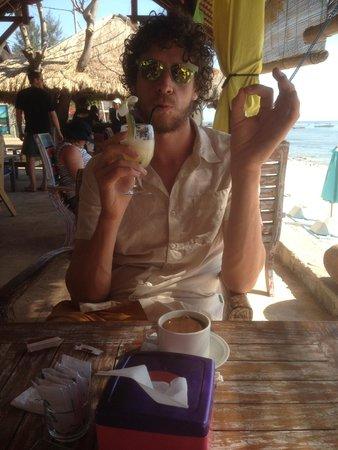 Sunrise Resort: My fella enjoying the fresh pineapple juice with breakfast