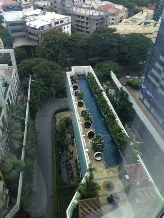 The Ritz-Carlton, Bangalore : A look down at the pool from the 14th floor