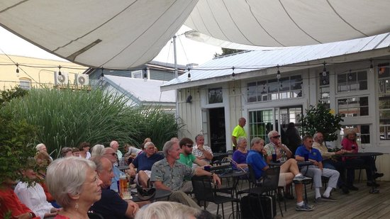 "Mathews, VA: Crowd enjoying live bluegrass music from ""Rebecca Frasier with Hit and Run"" in the outdoor court"