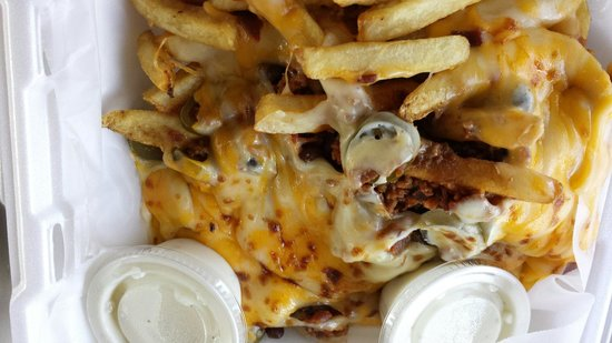 Mystic Diner and Restaurant: Loaded fries with chili - French fries, chili, bacon, cheese, jalapenos, ranch dressing.