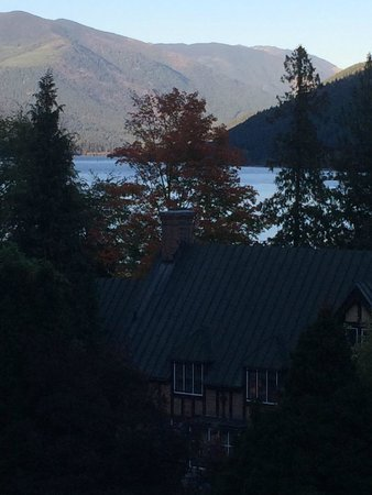 The Blaylock Mansion: View from the garden looking out over the house to the lake at sunset