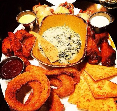 Hard Rock Cafe: JUMBO COMBO-Signature Wings, Onion Rings, Tupelo Chicken Tenders, Spinach Artichoke Dip w/Parmes