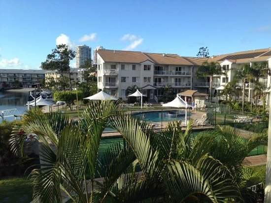 Pelican Cove Apartments: Pools/tennis court, rest of building
