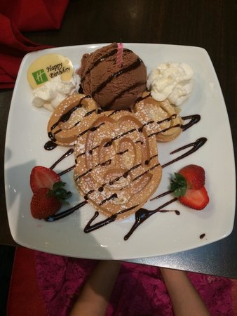 Holiday Inn Orlando – Disney Springs Area: The restaurant brought this out for my daughter-- Mickey Waffles and I scream! Along with candle