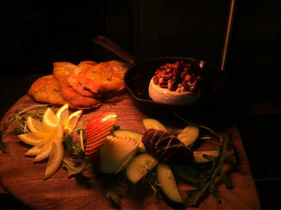 Bojangles': Oven warmed Brie served with honey mixed nuts with stepped apple,fig and pepper paste and lemon