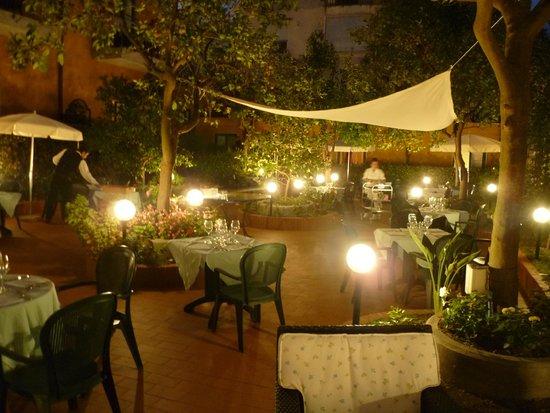 Astoria Hotel: View of garden restaurant from bar area at night
