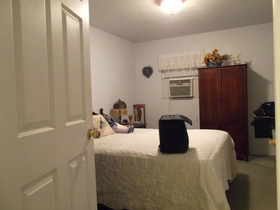 Lavender Dreams Bed and Breakfast Cottage: (our bag on bed)
