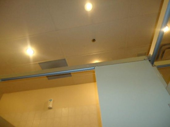Bathroom Light Not Bright Enough my foot/knees touching toilet. stall not wide enough for 1 person