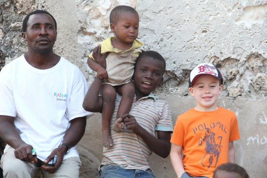 Matemwe Lodge, Asilia Africa: My Son with some Village children