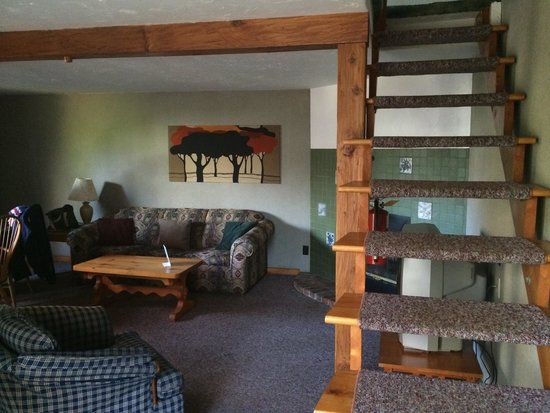 Town and Country Motor Inn: Cottage Living room and stairs to bedroom.