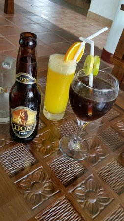 Wunderbar, Bentota, SL - selection  of drinks, pina  colada,  Cuba  libre,  Lion  beer